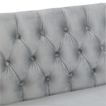 grey velvet studded backrest of sofa