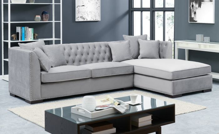 grey velvet corner sofa with studs