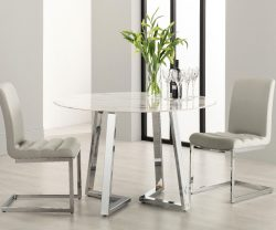 Derrys Storm round marble effect dining table with grey dining chairs