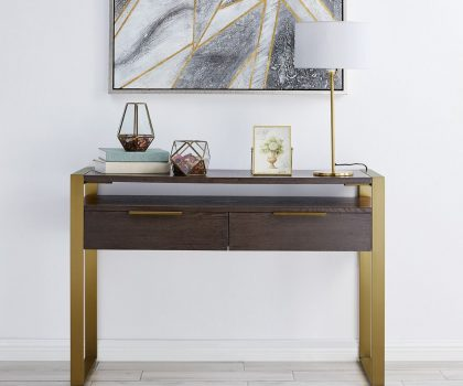 two drawer console table made from dark wood with gold legs