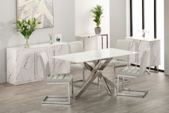 White marble dining table with steel frame and four grey fabric dining chairs